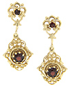 Crafted of 14K yellow gold, these antique style earrings are set with faceted round garnets
