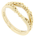 Gold bead designs decorate these 14K yellow gold curved wedding bands
