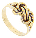 This antique style ring features an intricate knot design