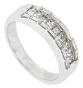 Seven square diamonds are set in a row across the top of this 18K white gold vintage wedding band