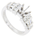 Rows of square diamonds alternate with a row of baguette diamonds on each shoulder of this 14K white gold antique style engagement ring mounting
