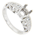 Round diamonds set in leaf shapes decorate the sides of this 14K white gold antique style engagement ring mounting