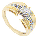 This 14K yellow gold retro-modern engagement ring features a faceted round diamond centrally set with smaller diamonds set in white gold running down the sides