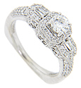 Round and baguette diamonds .70 carats total weight are set in the shoulders and sides of this 14K white gold antique style engagement ring