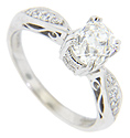 Quartets of diamonds adorn the shoulders of this 14K white gold antique style engagement ring