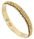 Raised floral designs wrap around the circumference of this 14K yellow gold antique men's wedding band