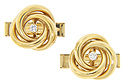 A single diamond ornaments the center of each of these 14K yellow gold retro-modern cuff links