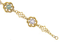 Multi-colored gemstones are set in this 14K yellow gold vintage bracelet