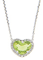 A ring of faceted round diamonds surround the heart shaped peridot on the pendant of this 14K white gold antique style necklace