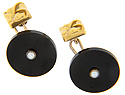 These antique cuff links are crafted of black onyx and 14K yellow gold
