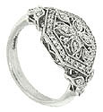 There are .40 carats of diamonds set in floral designs in this 14K white gold antique style engagement ring