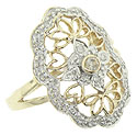 14K white and yellow gold flourishes ornament the surface of this lovely estate diamond ring