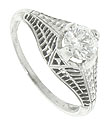 Floral engraving and lattice work decorate this 14K white gold antique engagement ring