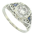 This spectacular antique engagement ring is set with a .38 carat, H color, Si2 clarity round diamond