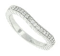 Faceted round diamonds are set around three quarters of the circumference of this 14K white gold curved wedding band
