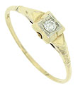 A round sparkling diamond is set in the square face of this 14K yellow gold vintage engagement ring