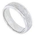 A trail of acanthus leaves covers the center of this 14K white gold mens wedding band