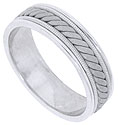 A rough finished twisting band of 14K white gold winds across the face of this handcrafted mens wedding band