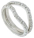 A garland of impressed flowers dance around the face of these 14K white gold curved wedding bands