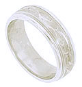 This 14K white gold mens handcrafted wedding band features a satin finish etched with brilliant curving vines