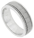Vertical lines press into the satin finished central band of this 14K white gold mens wedding band