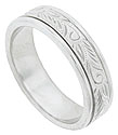 A stippled and engraved floral design covers the center of this 14k white gold mens wedding band