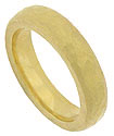 This handcrafted 22K yellow gold mens wedding band features a roughly hewn surface