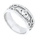 A brightly carved claddagh is the central focus of this 14K white gold modern mens wedding band