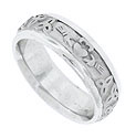 This 14K white gold mens modern wedding band features a claddagh decoration surrounded by celtic knots all in a matte finish