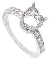 Round, faceted diamonds are set into the shoulders of this glittering antique style engagement ring mounting