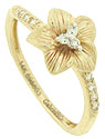 Five petals with engraved detailing cradle a trio of diamonds in the center of this 14K yellow gold antique style floral engagement ring