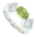 This breathtaking 14K white gold engagement ring features a 1.0 carat faceted oval peridot