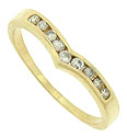 This 14K yellow gold estate wedding band features a row of sparkling round channel set diamonds