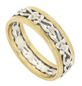 A delicate chain of white gold pansies and softly tied ribbons wrap around the center of this 14K bi-color wedding band