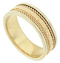 A floral engraved band flanked by bold twisting ropes is the focus of this 14K yellow gold mens wedding band
