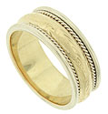 This 14K yellow gold mens wedding band features a smooth polished central band engraved with a repeating pattern of diagonals and organics