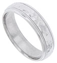 A multi-faceted hewn surface covers the face of this 14K white gold mens wedding band