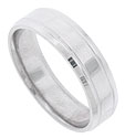Impressed strips of distinctive milgrain are the sole decoration on this 14K white gold mens wedding band