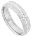 This rough textured 14K white gold mens wedding band has a deeply engraved central ring interrupted by four wide spaced vertical grooves