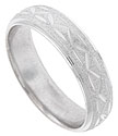 The textured surface of this 14K white gold mens wedding band is decorated with a deeply carved abstract organic design