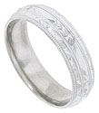 Sparsely placed engraved florals flanked by impressed milgrain and carved faceted stripes are the focus of this mens 14K white gold wedding band