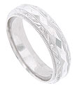 A faceted jewel cut band is the central focus of this 14K white gold mens wedding band
