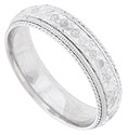Ropes of twisting white gold and bold milgrain frame a band of deeply engraved florals on this 14K white gold mens wedding band