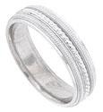 This 14K white gold mens wedding band features a bold center stripe of distinctive milgrain framed by additional bands of both impressed and engraved milgrain decoration