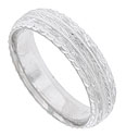 This intricately engraved 14K white gold mens wedding band features stripes of organic engraving, starbursts and deeply carved edges