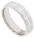 The rough carved surface of this 14K white gold mens wedding band is interrupted by a deeply carved stripe running down the center of the band