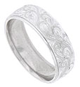 A twisting pattern of richly engraved organic shapes covers the face of this 14K white gold mens wedding band