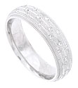 The rough textured surface of this 14K white gold mens wedding band is engraved with three evenly spaced grooves