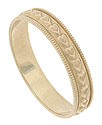 This charming 14K yellow gold estate wedding band is decorated with a ring of engraved hearts