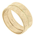 This pair of 14K yellow gold vintage wedding bands is decorated with engraved zigzags and small circles